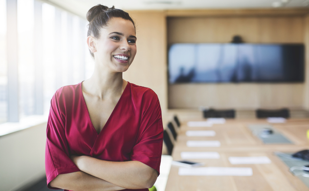 smiling-woman-in-conference-room